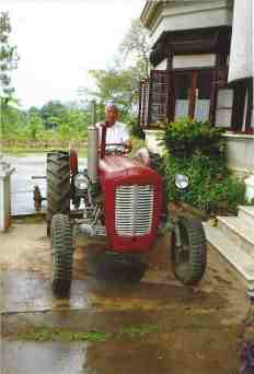 Mr Donald sitting on his tractor at the entrance to his palace in Hsipaw.